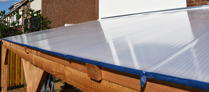 Materiaal voor het dak van uw overkapping: glas of kunststof?